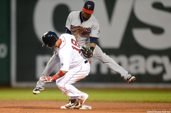 """""""Boston Red Sox right fielder Shane Victorino slides after stealing second base during the third inning of a game against the Minnesota Twins Thursday, May 9, 2013 at Fenway Park."""""""