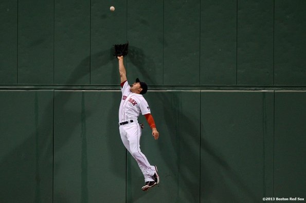 """""""Boston Red Sox center fielder Jacoby Ellsbury leaps as he attempts to catch a deep fly ball during the fifth inning of a game against the Minnesota Twins Thursday, May 10, 2013 at Fenway Park."""""""