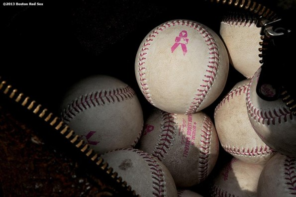 """""""Pink-laced baseballs are shown in honor of Mother's Day Sunday, May 12, 2013 at Fenway Park in Boston, Massachusetts."""""""