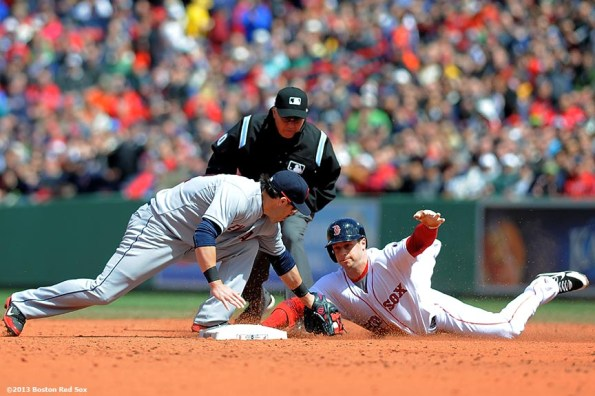 """""""Boston Red Sox outfielder Daniel Nava is tagged out by second baseman Jason Kipnes as he slides into second base after driving in a run during the third inning of a game against the Cleveland Indians at Fenway Park in Boston, Massachusetts Sunday, May 26, 2013."""""""