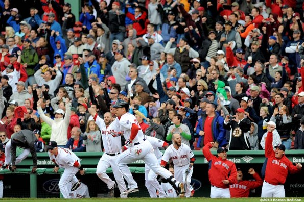 """""""Members of the Boston Red Sox celebrate as center fielder Jacoby Ellsbury rounds first base after hitting a walk-off single in the bottom of the ninth inning to defeat the Cleveland Indians 6-5 at Fenway Park in Boston, Massachusetts Sunday, May 26, 2013. The Red Sox came back from a 5-1 deficit in the eighth inning."""""""