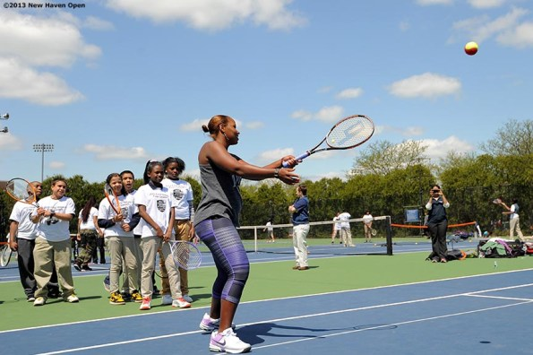 """""""Professional Tennis Player Taylor Townsend leads a volley drill Monday, May 13, 2013 at a free tennis lesson promotional event leading up to the New Haven Open Tennis Tournament at Yale University in New Haven, Connecticut."""""""