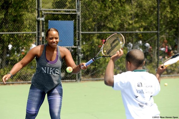 """""""Professional Tennis Player Taylor Townsend leads a volley drill Monday, May 13, 2013 at a free tennis lesson promotional event leading up to the New Haven Open Tennis Tournament at Yale University in New Haven, Connecticut. Over three hundred children from ten New Haven public schools attended the event."""""""