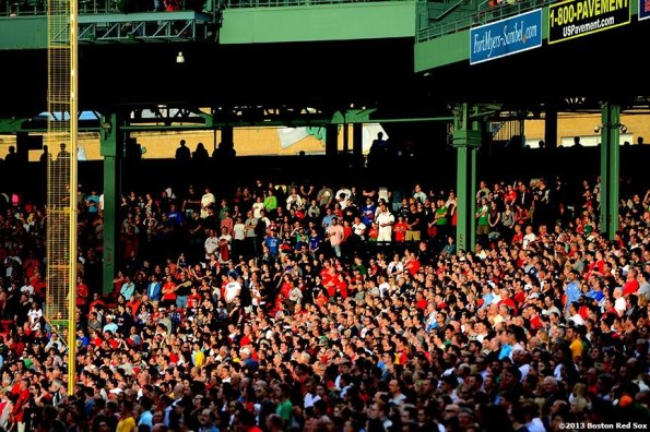 """""""Fans stand for the National Anthem before a game between the Boston Red Sox and the Los Angeles Angels of Anaheim Saturday, June 8, 2013 at Fenway Park in Boston, Massachusetts."""""""