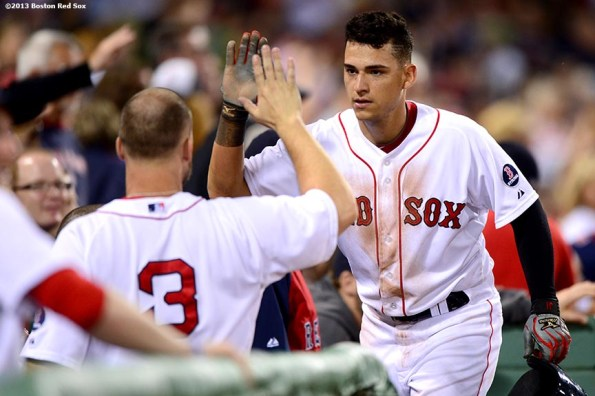 """""""Boston Red Sox third baseman Jose Iglesias high fives teammates after scoring in the sixth inning of a game against the Los Angeles Angels of Anaheim Saturday, June 8, 2013 at Fenway Park in Boston, Massachusetts."""""""