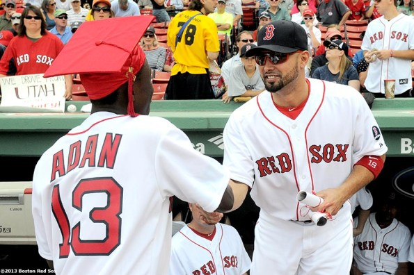 """""""Boston Red Sox outfielder Shane Victorino congratulates a Red Sox graduating Scholar during a pre-game ceremony Sunday, June 10, 2013 at Fenway Park in Boston, Massachusetts."""""""