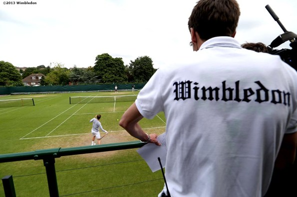 """""""A reporter watches as Andy Murray practices at the All England Lawn and Tennis Club in London, England Thursday, June 27, 2013 during the 2013 Championships Wimbledon."""""""