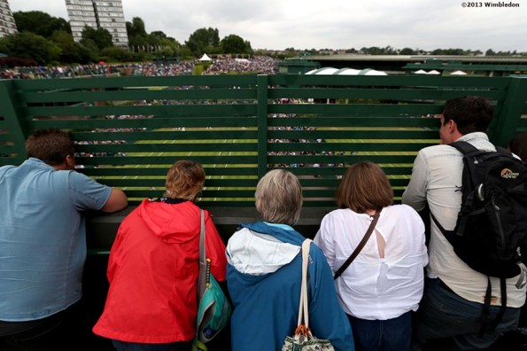 """""""Fans crowd together to get a view of No. 14 Court at the All England Lawn and Tennis Club in London, England Friday, June 28, 2013 during the 2013 Championships Wimbledon."""""""