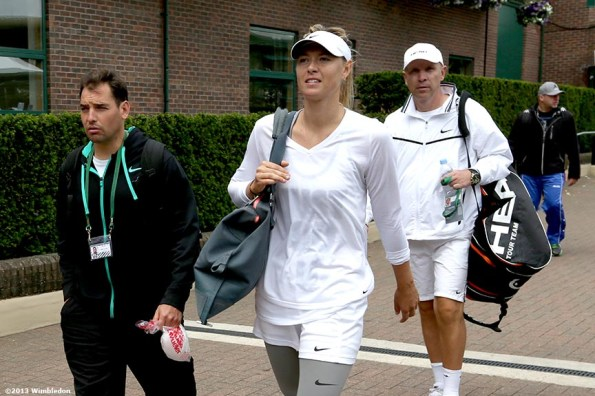 """""""Maria Sharapova leaves the practice courts at the All England Lawn and Tennis Club in London, England Saturday, June 22, 2013 before the start of the 2013 Championships Wimbledon."""""""