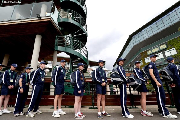 """""""A group of ball boys and ball girls stand in line at the All England Lawn and Tennis Club in London, England Saturday, June 22, 2013 before the start of the 2013 Championships Wimbledon."""""""