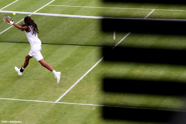 """""""Dustin Brown lunges for a volley at the All England Lawn and Tennis Club in London, England Friday, June 28, 2013 during the 2013 Championships Wimbledon."""""""