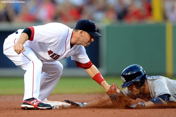 """""""Boston Red Sox shortstop Stephen Drew applies a tag at second base on left fielder Sean Rodriguez during the fourth inning of a game against the Tampa Bay Rays Monday, July 29, 2013 at Fenway Park in Boston, Massachusetts."""""""