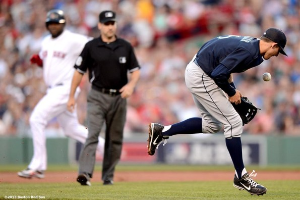 """""""Seattle Mariners shortstop Brad Miller makes an error while fielding a ground ball during the second inning of a game against the Boston Red SoxTuesday, July 30, 2013 at Fenway Park in Boston, Massachusetts."""""""