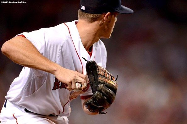 """""""Boston Red Sox third baseman Brock Holt throws toward first base during the seventh inning of a game against the the Seattle Mariners Wednesday, July 31, 2013 at Fenway Park in Boston, Massachusetts."""""""