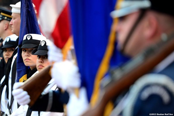 """""""The color guard awaits a Military appreciation ceremony before a game between the Boston Red Sox and the Seattle Mariners Wednesday, July 31, 2013 at Fenway Park in Boston, Massachusetts."""""""