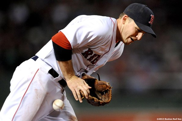 """""""Boston Red Sox shortstop Stephen Drew bobbles a ground ball during the third inning of a game against the Baltimore Orioles Thursday, August 29, 2013 at Fenway Park in Boston, Massachusetts."""""""