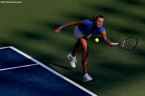 """""""Petra Kvitova lunges to return a serve on Day 5 of the New Haven Open at Yale University in New Haven, Connecticut Tuesday, August 20, 2013."""""""