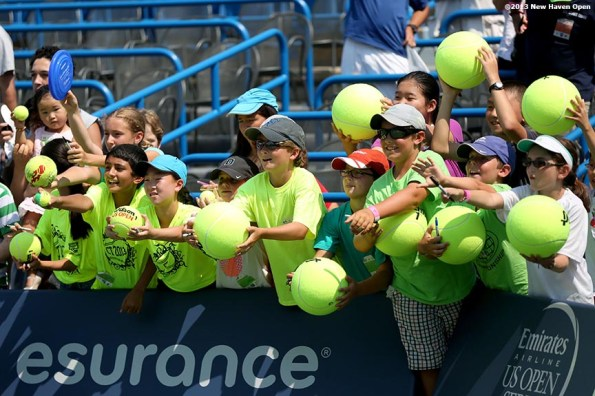 """""""Fans line up for autographs on Stadium Court following a match on Day 5 of the New Haven Open at Yale University in New Haven, Connecticut Tuesday, August 20, 2013."""""""