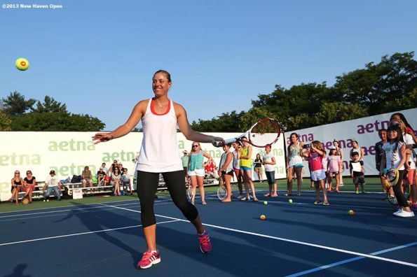 """""""Angelique Kerber hits a forehand during a demonstration at a 'Girl Scout Day' tennis clinic on Day 5 of the New Haven Open at Yale University in New Haven, Connecticut Tuesday, August 20, 2013."""""""
