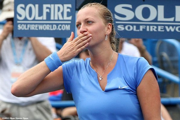 """""""Petra Kvitova blows a kiss as she acknowledges the crowd on Stadium Court after defeating Klara Zakopalova in the semi-finals on Day 8 of the New Haven Open at Yale University in New Haven, Connecticut Friday, August 20, 2013."""""""