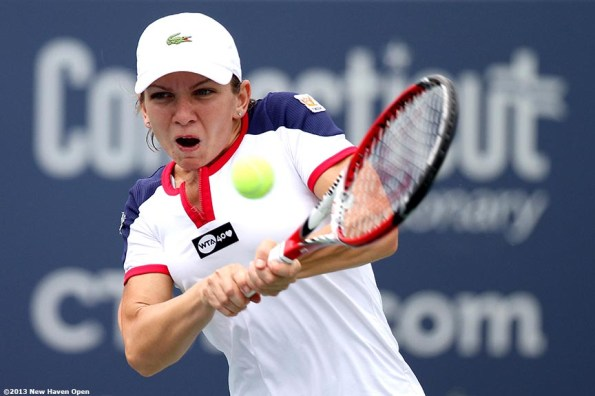 """""""Simona Halep hits a backhand on Day 4 of the New Haven Open at Yale University in New Haven, Connecticut Monday, August 19, 2013."""""""