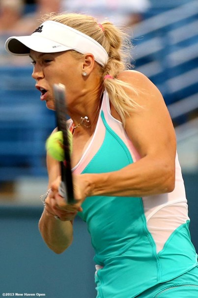 """""""Caroline Wozniacki connects on a forehand during her semi-final match against Simona Halep on Day 8 of the New Haven Open at Yale University in New Haven, Connecticut Friday, August 20, 2013."""""""