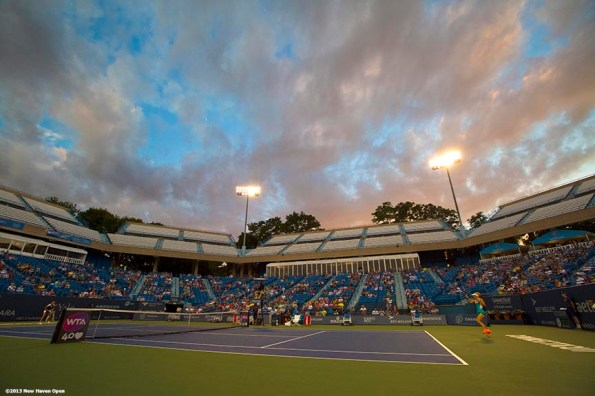 """""""The sun sets as Caroline Wozniacki and Simona Halep play in a semi-final match on Stadium Court on Day 8 of the New Haven Open at Yale University in New Haven, Connecticut Friday, August 20, 2013."""""""