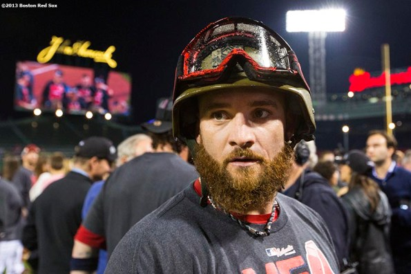 """""""Boston Red Sox outfielder Jonny Gomes celebrates in a helmet and goggles on the field after the Red Sox clinched the American League East title with a 6-3 win over the Toronto Blue Jays Friday, September 20, 2013 at Fenway Park."""""""