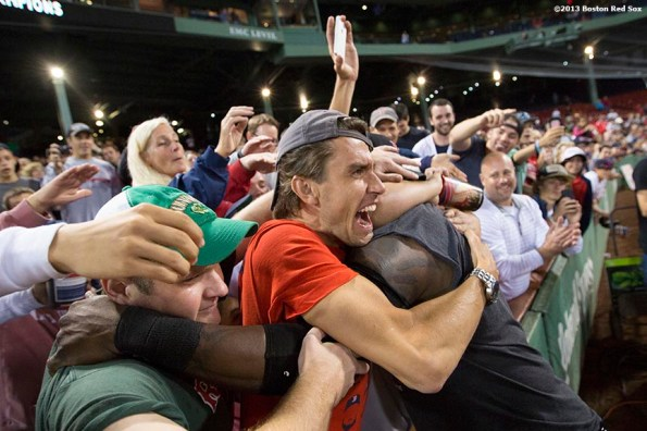 """""""Boston Red Sox designated hitter David Ortiz is mobbed by fans during an on-field celebration after the Red Sox clinched the American League East title with a 6-3 win over the Toronto Blue Jays Friday, September 20, 2013 at Fenway Park."""""""