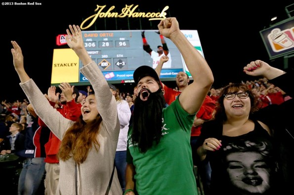 """""""Fans cheer during a game between the Boston Red Sox and the Toronto Blue Jays Friday, September 22, 2013. The Red Sox clinched the American League East title with a 6-3 win over the Toronto Blue Jays."""""""