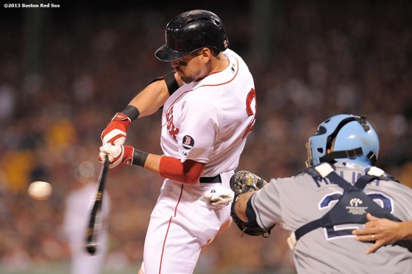 """""""Boston Red Sox center fielder Jacoby Ellsbury hits an RBI single during the third inning of game two of the American League Division Series against the Tampa Bay Rays Saturday, October 5, 2013 at Fenway Park in Boston, Massachusetts."""""""