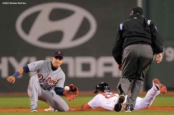 """""""Boston Red Sox pinch runner Quintin Berry steals second base during the ninth inning of game one of the American League Championship Series against the Detroit Tigers Saturday, October 12, 2013 at Fenway Park in Boston, Massachusetts."""""""