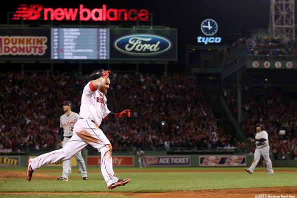 """""""Boston Red Sox left fielder Jonny Gomes celebrates as he scores the game-winning run on a walk-off single by catcher Jarrod Saltalamacchia during the ninth inning of game two of the American League Championship Series against the Detroit Tigers Sunday, October 13, 2013 at Fenway Park in Boston, Massachusetts."""""""