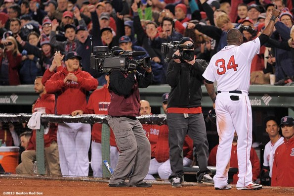 """""""Boston Red Sox designated hitter David Ortiz gives a curtain call after hitting a game-tying grand slam home run during the eighth inning of game two of the American League Championship Series against the Detroit Tigers Sunday, October 13, 2013 at Fenway Park in Boston, Massachusetts."""""""