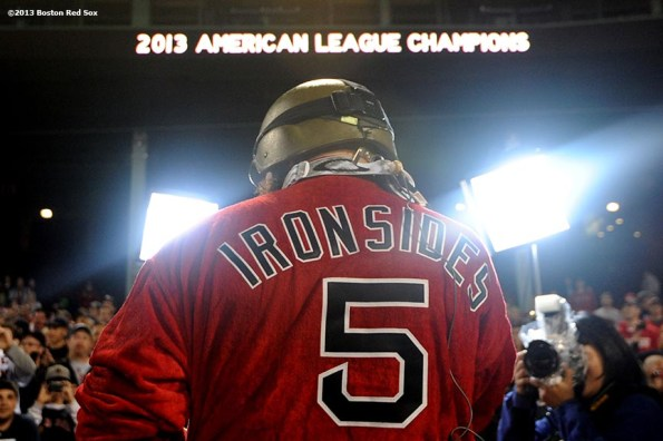 """""""Boston Red Sox right fielder Jonny Gomes wears an 'Ironsides' Red Sox bathrobe as he celebrates during an on-field celebration after winning game six of the American League Championship Series against the Detroit Tigers and advancing to the World Series Saturday, October 19, 2013 at Fenway Park in Boston, Massachusetts."""""""