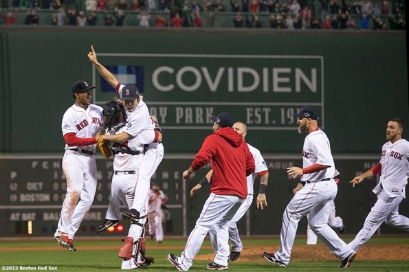 """""""Boston Red Sox pitcher Koji Uehara, catcher Jarrod Saltalamacchia, and teammates celebrate after winning game six of the American League Championship Series against the Detroit Tigers and advancing to the World Series Saturday, October 19, 2013 at Fenway Park in Boston, Massachusetts."""""""