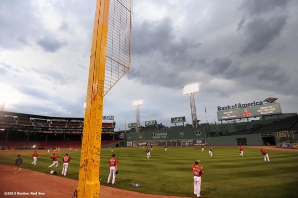 """""""Boston Red Sox players warm up during a team workout before game one of the 2013 World Series against the St. Louis Cardinals Tuesday, October 22, 2013 at Fenway Park in Boston, Massachusetts."""""""