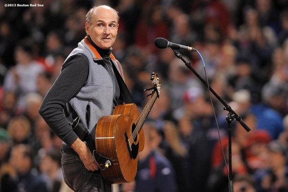 """""""Singer James Taylor is introduced before singing the National Anthem during a pre-game ceremony before game two of the 2013 World Series between the Boston Red Sox and the St. Louis Cardinals Thursday, October 24, 2013 at Fenway Park in Boston, Massachusetts."""""""