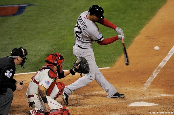 """""""Boston Red Sox third baseman Xander Bogaerts hits a triple during the fifth inning of game three of the 2013 World Series against the St. Louis Cardinals Saturday, October 26, 2013 at Busch Stadium in St. Louis, Missouri."""""""