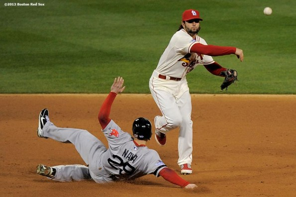 """""""Boston Red Sox left fielder Daniel Nava slides into second base as shortstop Pete Kozma turns a double play during the sixth inning of game three of the 2013 World Series against the St. Louis Cardinals Saturday, October 26, 2013 at Busch Stadium in St. Louis, Missouri."""""""