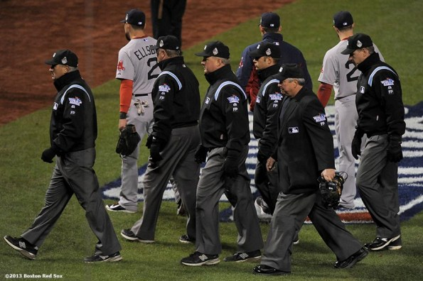 """""""Umpires walk off the field after the St. Louis Cardinals defeated the Boston Red Sox in game three of the 2013 World Series on a fielder's interference call in the ninth inning by third base umpire Jim Joyce Saturday, October 26, 2013 at Busch Stadium in St. Louis, Missouri."""""""