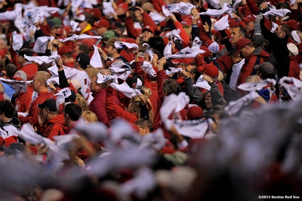 """""""Fans wave towels during a pre-game ceremony before game three of the 2013 World Series between the Boston Red Sox and the St. Louis Cardinals Saturday, October 26, 2013 at Busch Stadium in St. Louis, Missouri."""""""