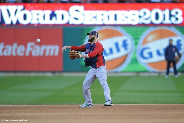 """""""Boston Red Sox second baseman Dustin Pedroia takes ground balls before game four of the 2013 World Series against the St. Louis Cardinals Sunday, October 27, 2013 at Busch Stadium in St. Louis, Missouri."""""""