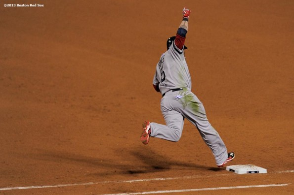 """""""Boston Red Sox left fielder Jonny Gomes celebrates after hitting a go-ahead three run home run during the sixth inning of game four of the 2013 World Series against the St. Louis Cardinals Sunday, October 27, 2013 at Busch Stadium in St. Louis, Missouri."""""""