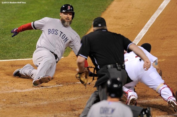 """""""Boston Red Sox shortstop catcher David Ross is tagged out while attempting to score on an RBI single by center fielder Jacoby Ellsbury during the seventh inning of game five of the 2013 World Series against the St. Louis Cardinals Monday, October 28, 2013 at Busch Stadium in St. Louis, Missouri."""""""