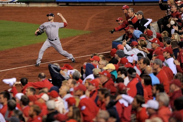 """""""Boston Red Sox right fielder Daniel Nava throws to second base during the eighth inning of game five of the 2013 World Series against the St. Louis Cardinals Monday, October 28, 2013 at Busch Stadium in St. Louis, Missouri."""""""
