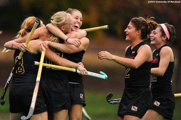 """""""University of Maryland foreword Alyssa Parker (center) celebrates with teammates after Maryland scored a goal during the ACC Field Hockey Conference Championship game against the University of North Carolina Sunday, November 10, 2013 at Boston College in Newton, Massachusetts."""""""