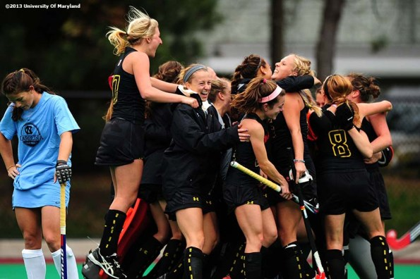 """""""The University of Maryland field hockey team celebrates after defeating the University of North Carolina to win the ACC Field Hockey Conference Championship game Sunday, November 10, 2013 at Boston College in Newton, Massachusetts."""""""
