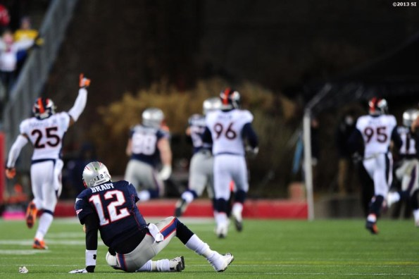 """""""New England Patriots quarterback Tom Brady reacts as Denver Broncos players celebrate after recovering a fumble Sunday, November 24, 2013 at Gillette Stadium in Foxborough, Massachusetts."""""""