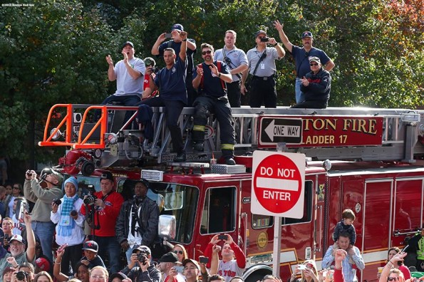 """""""Firefighters cheer along Boylston Street during the Rolling Rally World Series Championship Parade through downtown Boston, Massachusetts Saturday, November 2, 2013."""""""